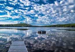 Summer Clouds reflection by John Morse